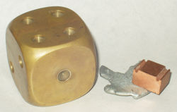 (L-R) Decorative brass paperweight, along with zinc and copper samples