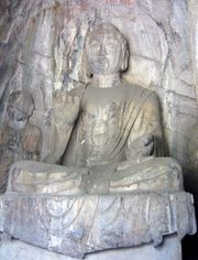 A Tang Dynasty sculpture of Amitabha Buddha, found in the Hidden Stream Temple Cave, Longmen Grottoes, China indicates.