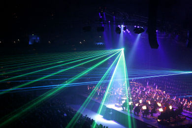 Dark lighting in a concert hall allow laser effects to be visible