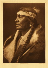 An Atsina named Assiniboin BoyPhoto by Edward S. Curtis.