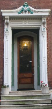 The front door of a house is often decorated to appear inviting.