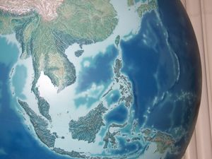 Relief Map of SE Asia on the globe at the Field Museum, Chicago, Illinois, United States
