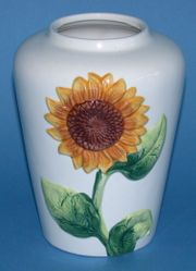 A vase with a sunflower pattern