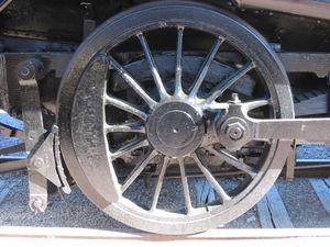 A driving wheel on a steam locomotive.
