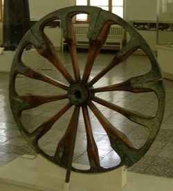 A spoked wheel on display at The National Museum of Iran, in Tehran. The wheel is dated late second millennium BCE  and was excavated at Choqa Zanbil.