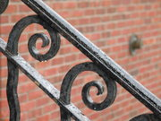A wrought iron railing in Troy, New York.